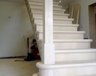 Honed Botticino marble staircase complete with marble knewl posts and 2 grand steps with rounded ends