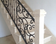 Honed Crema Marfil staircase, complete with stone newl post.